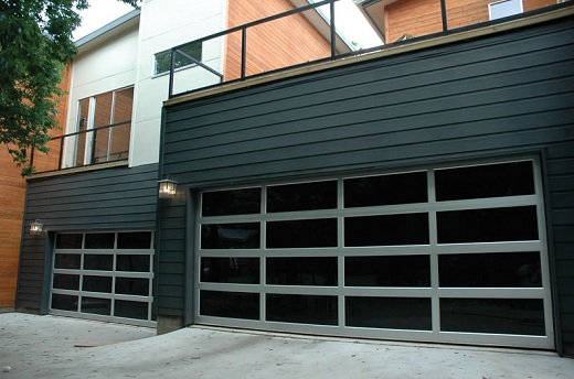 Modern Garage Door with Clear Anodized Aluminum and Clear Tempered Glass